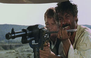 El Chuncho's a happy man when he has his machine gun